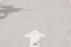 Directional arrow on the road.