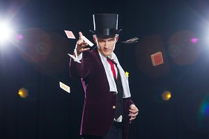 Magician, Juggler man, Funny person, Black magic, Illusion Man showing tricks with cards. threw cards