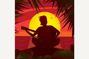 Man playing the guitar at sunset