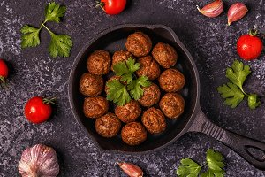 Roasted  meatballs with tomatoes