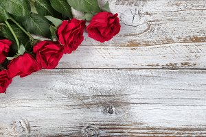 Red Roses on Rustic Wood
