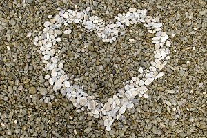 Heart symbol made of pebbles.