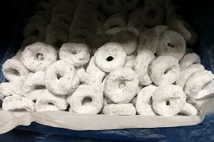 White donuts with sugar on a tray