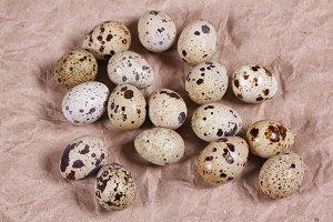 Quail eggs on brown paper