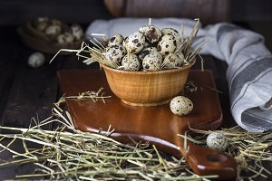 quail eggs in a wooden bowl