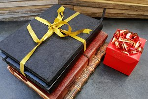 Notebooks with a gold ribbon