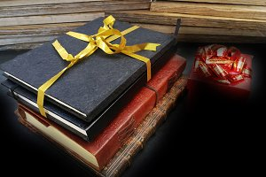 Notebooks tied with a golden ribbon