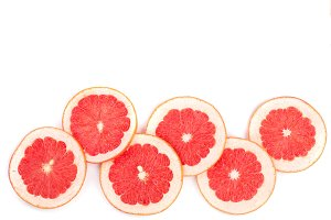 Grapefruit slices isolated on white background with copy space for your text. Top view. Flat lay pattern