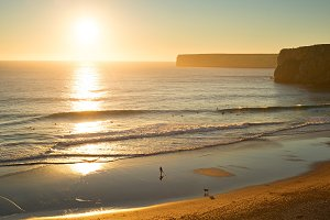 Surfers at sunset, Portugal.