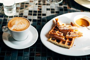cup of cappuccino with waffles