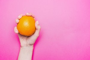 girl holding an orange