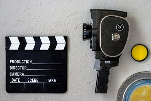 A movie camera and clapperboard