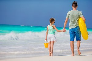 Family of father and little girl at tropical beach together
