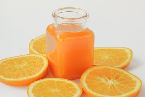 Bottle of orange juice with slices