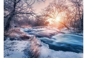 Winter landscape with snowy trees, ice, beautiful frozen river