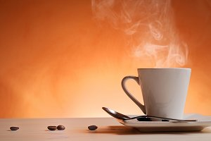 Cup of coffee with orange background