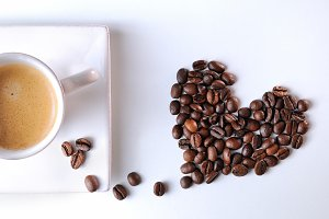Heart with grains and coffee cup