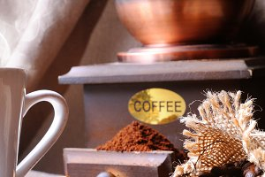 Cup of coffee and coffee grinder