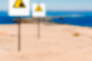 Beach alert sign - blurred image