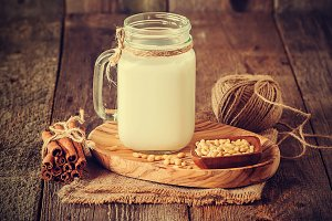 cedar milk in a glass jar and pine nuts