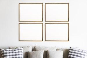 Four photo frames on the wall (PSD)