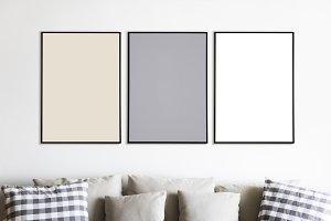 Three photo frames on wall (PSD)