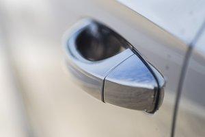 Handle of the door of a car.