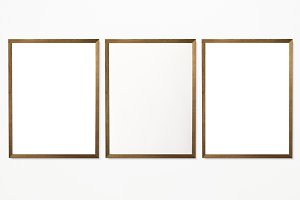 Three photo frames on wall (PSD)