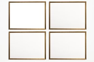 Four photo frames on wall (PSD)
