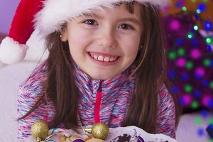 little girl with candy and christmas