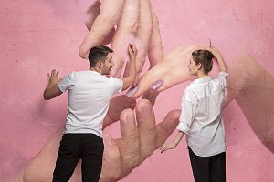 The collage about couple writing something on a pink wall