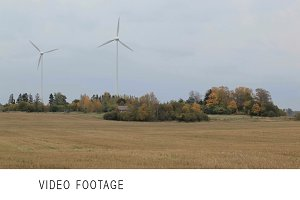 Two wind turbines in the field.