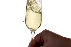 Hand holding glass of champagne