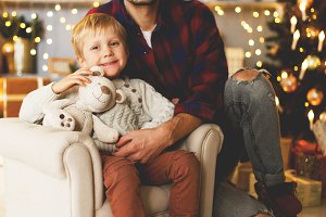 New Year's image of son in chair and father