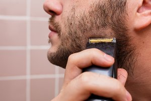 Man shaving with trimmer