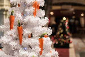 Photo of white Christmas tree adorned with carrots