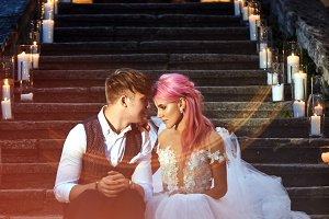 Bride with pink hair and groom