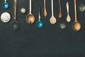 Flat-lay of old vintage kitchen spoons and baking tin molds