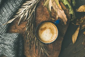 Autumn morning coffee concept with leaves and sweater, square crop