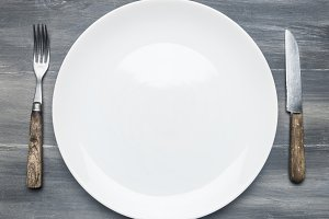 white empty plate on wooden table