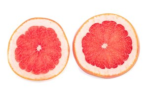 Grapefruit slices with leaves isolated on white background. Top view