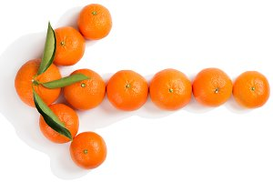 Tangerines arrow concept.