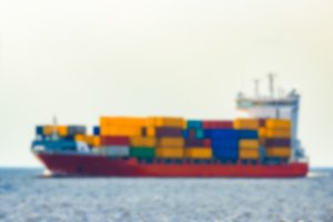 Red cargo ship - blurred image