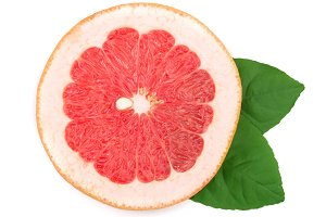 Grapefruit slice with leaves isolated on white background. Top view