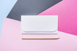 white envelope with colored paper