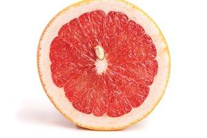 Grapefruit slices isolated on white background close-up