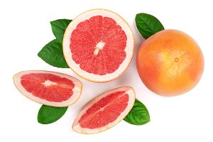 Grapefruit and slices with leaves isolated on white background. Top view. Flat lay pattern