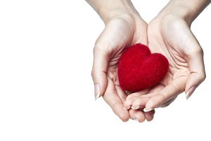 Red sweet heart in woman's hands
