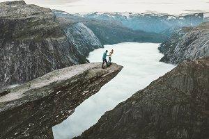 Couple Man and Woman on Trolltunga