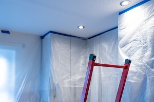 Kitchen covered with plastic ready for ceiling paint